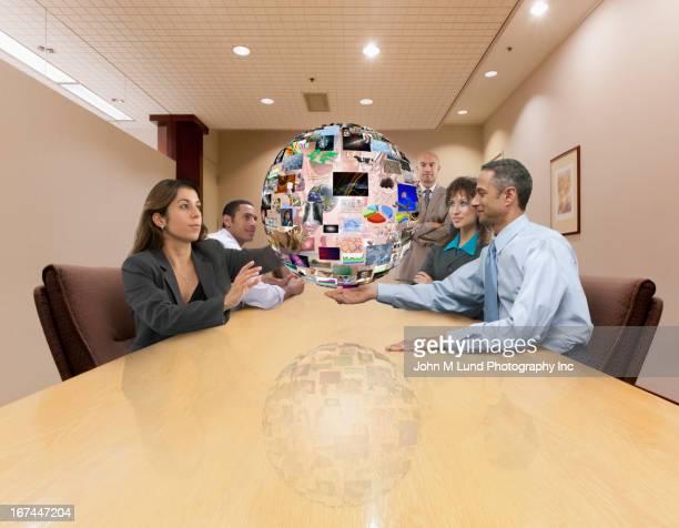 Business people admiring illustration of globe