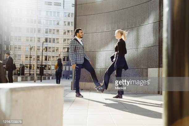 business people alternate greeting during pandemic - arab feet photos et images de collection