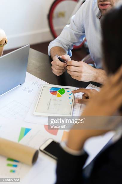 Business people analyzing data in office