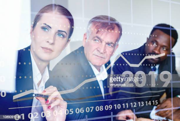 Business people analyzing financial chart with a financial analyst