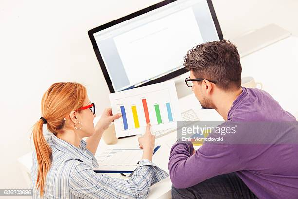 Business people analyzing market research statistics at home office