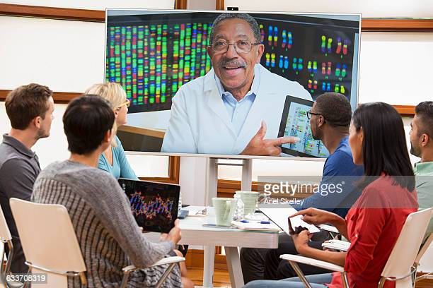 Business people and doctor video conferencing in meeting