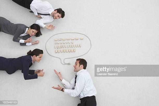 Business people and speech bubble, elevated view