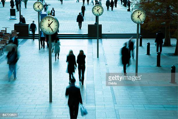 business people and time - canary wharf stock pictures, royalty-free photos & images