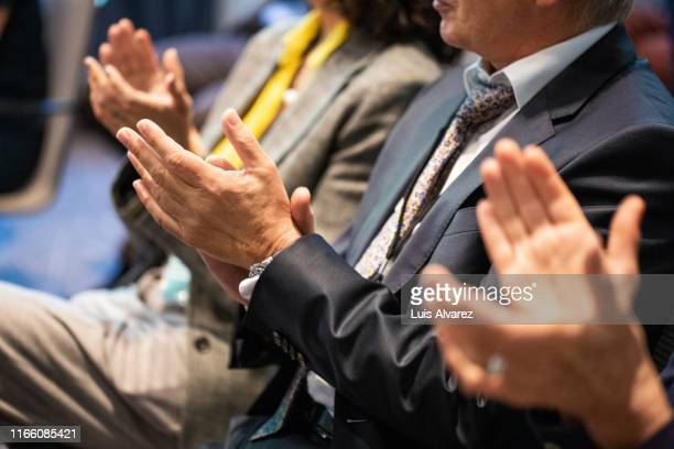 business people applauding during a seminar - formal stock pictures, royalty-free photos & images