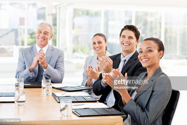 Business People Applauding In a Meeting