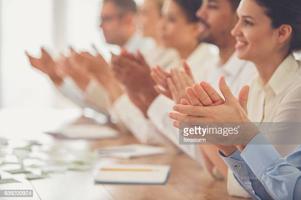 business people applauding in meeting - admiration stock pictures, royalty-free photos & images