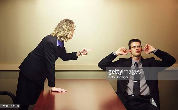 business people arguing - fingers in ears stock pictures, royalty-free photos & images