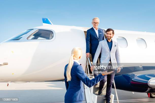 business people arriving by private jet at the airport - crew stock pictures, royalty-free photos & images