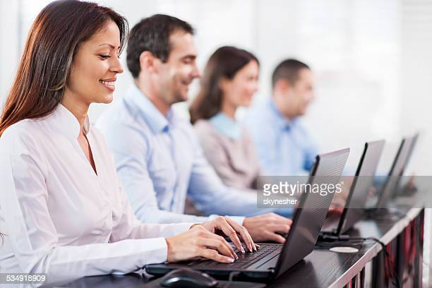 Business people at a computer class.
