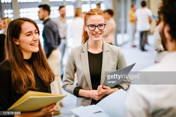 business people at a conference event - 30 39 years stock pictures, royalty-free photos & images