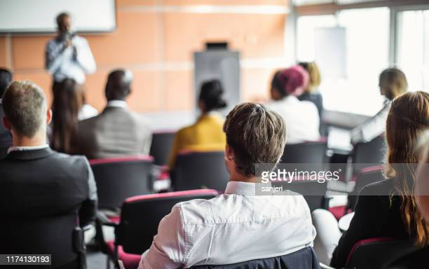 business people at a conference listening to the speaker - participant stock pictures, royalty-free photos & images