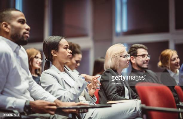 business people at a conference meeting - county stock pictures, royalty-free photos & images