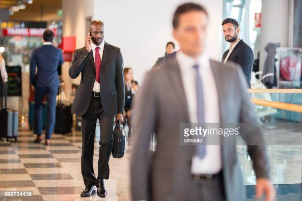 business people at airport - premium access stock pictures, royalty-free photos & images