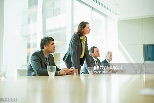 Business people at conference table in office