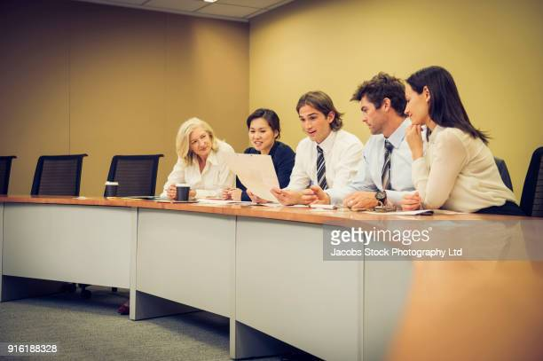 Business people at desk in conference