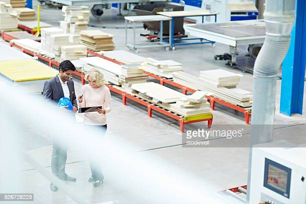Business people at factory shopfloor