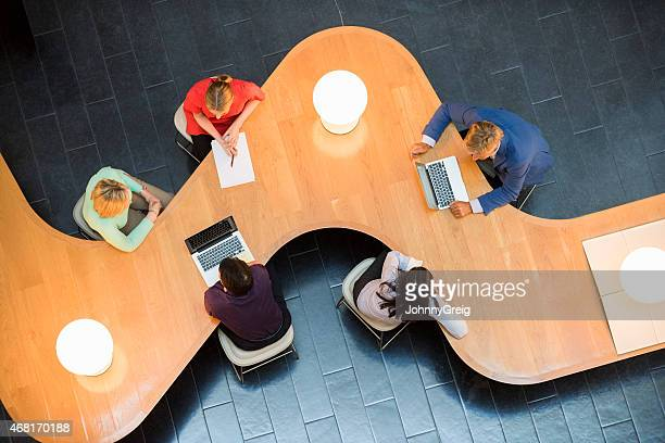 Business people at modern conference table
