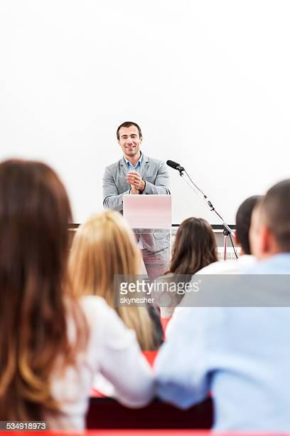 Business people at seminar.