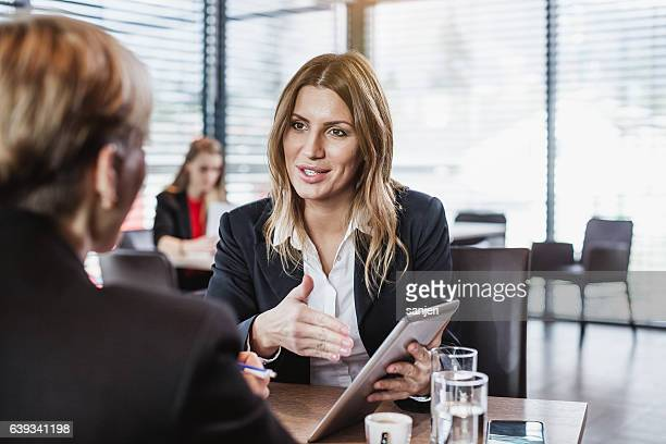 business people at the cafe restaurant - financial advisor stock pictures, royalty-free photos & images