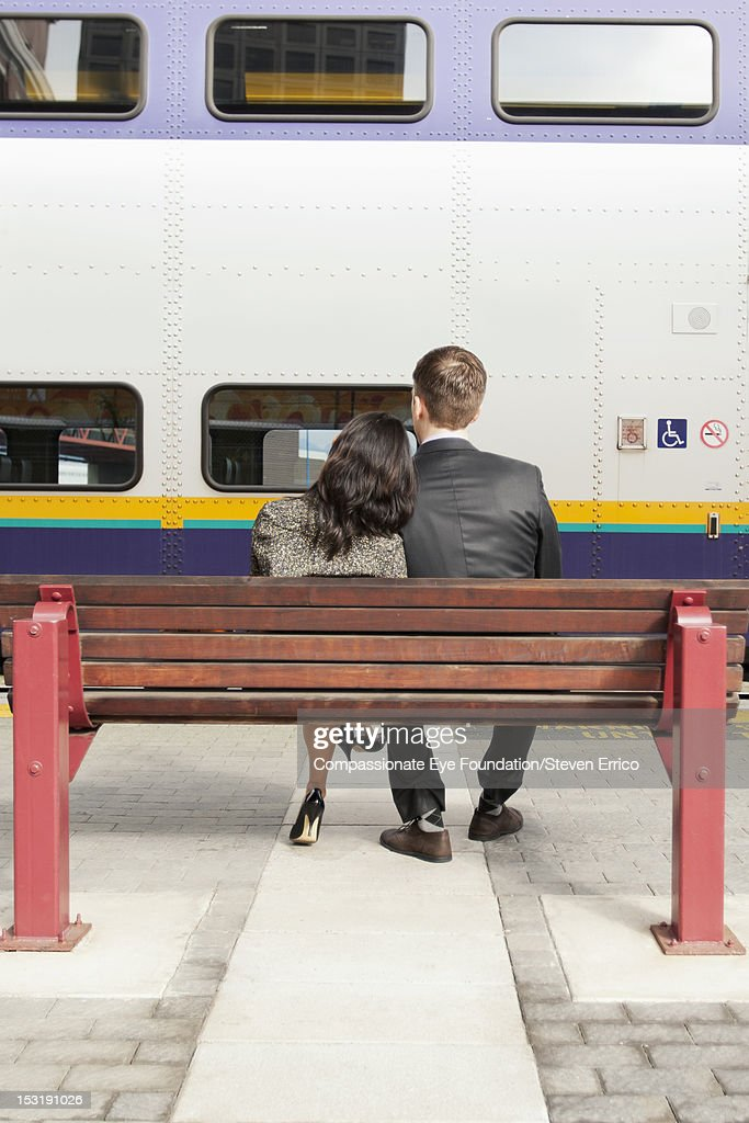 Business people at train station, rear view : Stock Photo