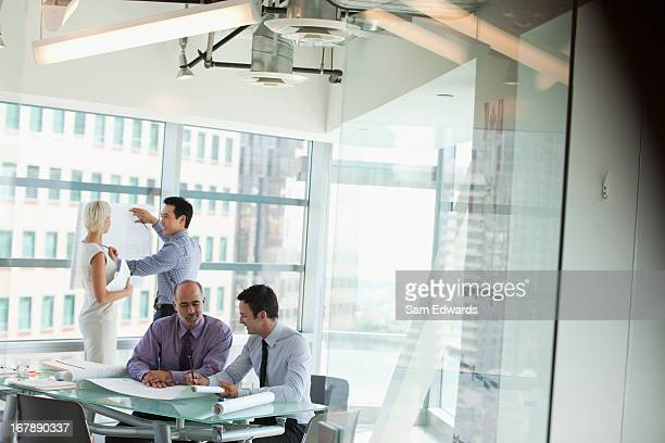 business people at work in office - printed media stock pictures, royalty-free photos & images