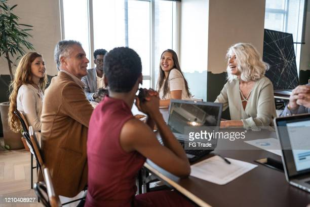 business people attending a business meeting / seminar in board room - sharing economy stock pictures, royalty-free photos & images