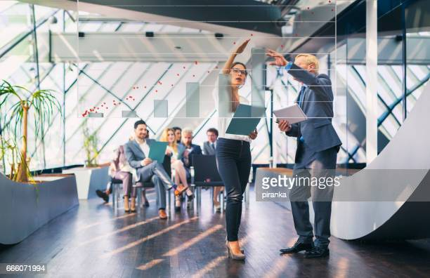 business people attending a business presentation - touch sensitive stock pictures, royalty-free photos & images