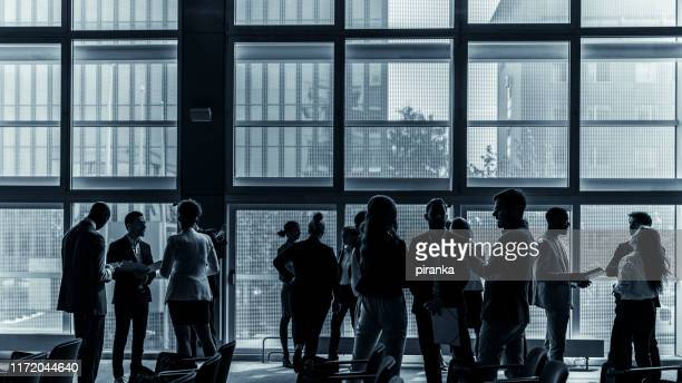 business people attending a conference - business conference stock pictures, royalty-free photos & images