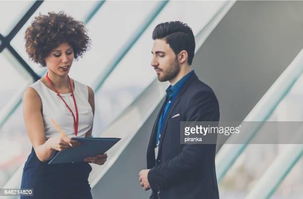 Business people attending a conference