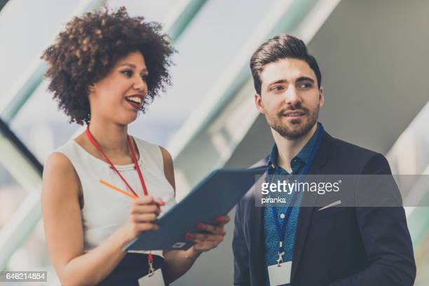 business people attending a conference - register stock photos and pictures