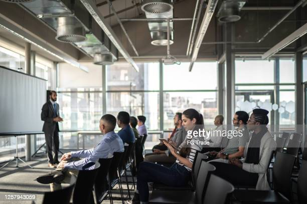 business people attending a seminar with social distancing - candidate stock pictures, royalty-free photos & images