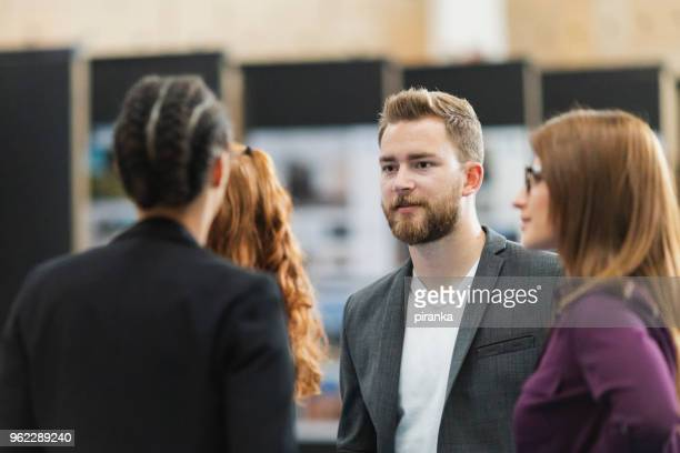 business people attending an exhibition - entertainment event stock pictures, royalty-free photos & images