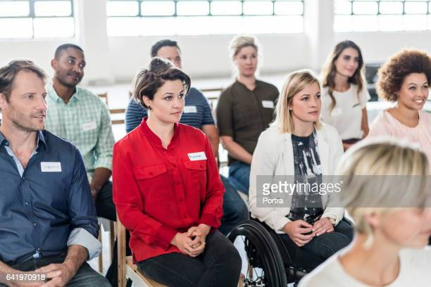 business people attending presentation in office - attending stock pictures, royalty-free photos & images