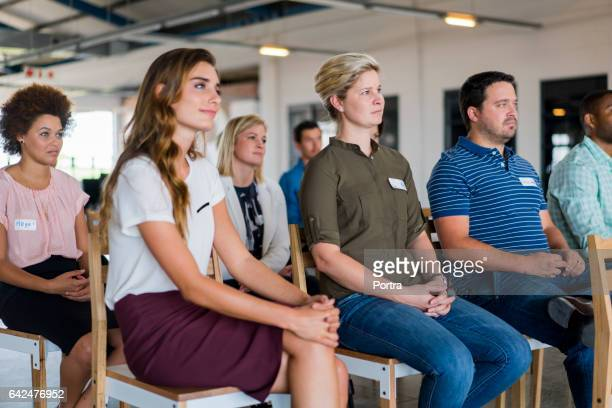 business people attending seminar in office - attending stock pictures, royalty-free photos & images