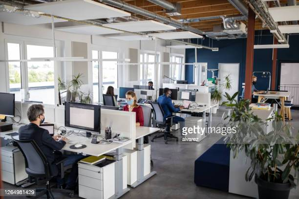business people back to work in the new normal during pandemic - department stock pictures, royalty-free photos & images