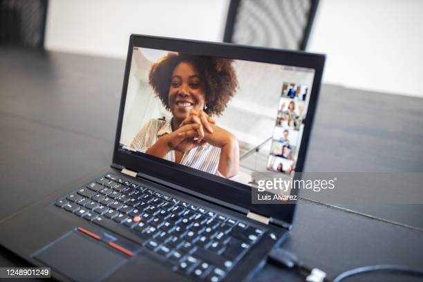 business people brainstorming ideas during a virtual meeting - covid-19 stock pictures, royalty-free photos & images