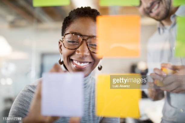 business people brainstorming ideas in office - imagination stockfoto's en -beelden