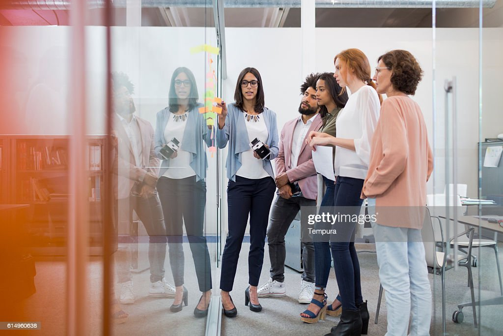 Business people brainstorming in conference room. : Stock Photo