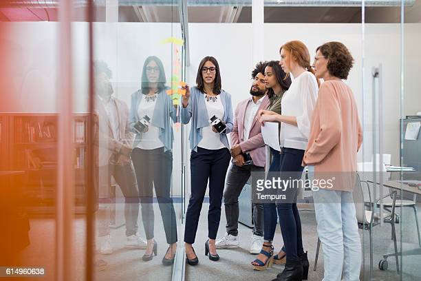 business people brainstorming in conference room. - culturen stockfoto's en -beelden