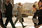 Business people busy using mobile phone while walking on street to office