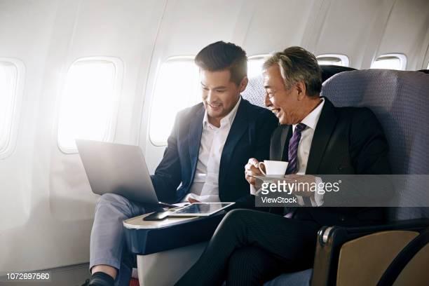 business people by plane - 出張 ストックフォトと画像