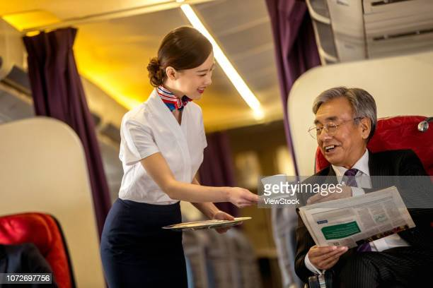 business people by plane - 乗員 ストックフォトと画像