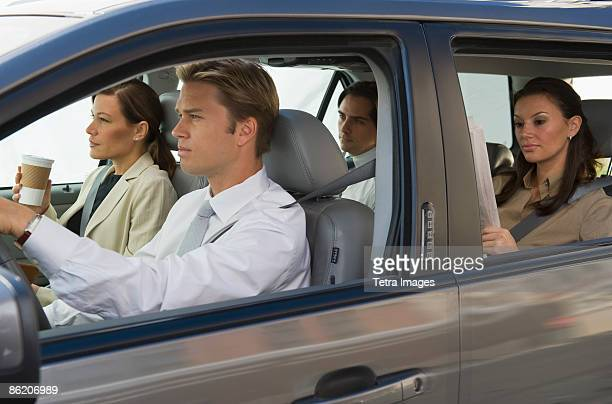 business people car pooling - car pooling stock photos and pictures