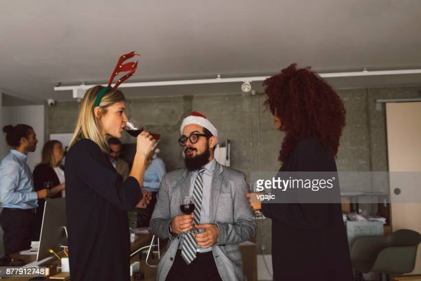 Business people celebrating Christmas At Workplace