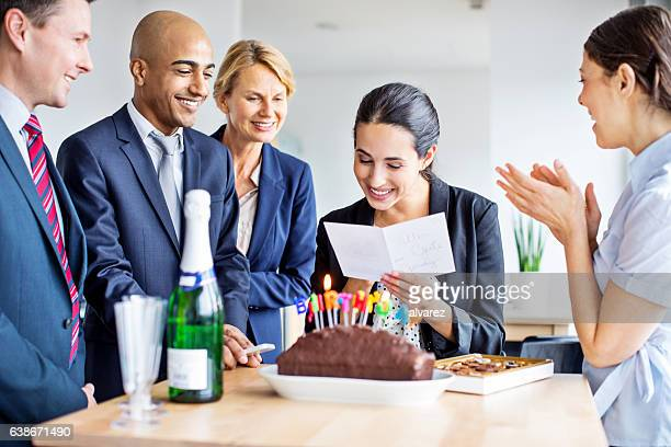 business people celebrating colleague's birthday in office - birthday card stock photos and pictures