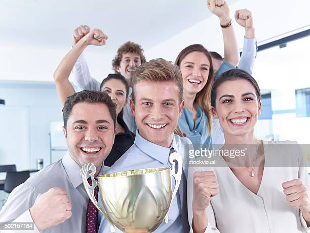 Business people celebrating cup