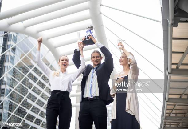 business people celebrating with team after hitting the target of business point - awards ceremony stock pictures, royalty-free photos & images