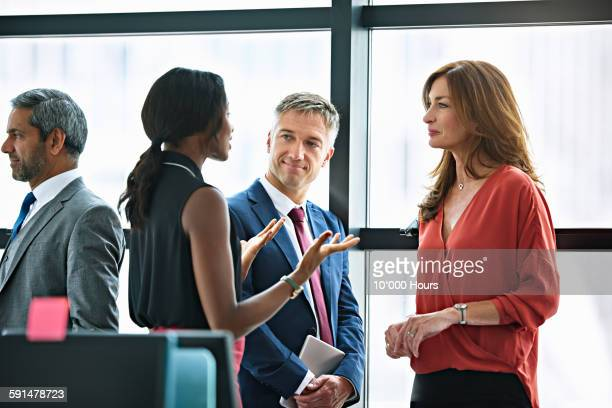 business people chatting before the meeting - full suit stock pictures, royalty-free photos & images