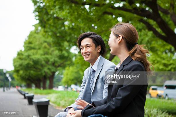 Business people chatting in the park